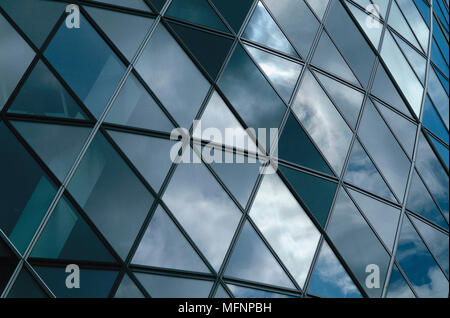 Reflection of clouds on the glass front of a building   Ref: CRB422_10029_034  Compulsory Credit: RESPONSE PHOTOGRAPH / Photoshot - Stock Photo