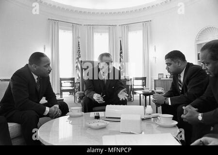 Lyndon Baines Johnson (1908-1973) 36th President of the United States in talks with Civil Rights leaders in the White House, including  Martin Luther King, Jr (1929-1968), left. - Stock Photo