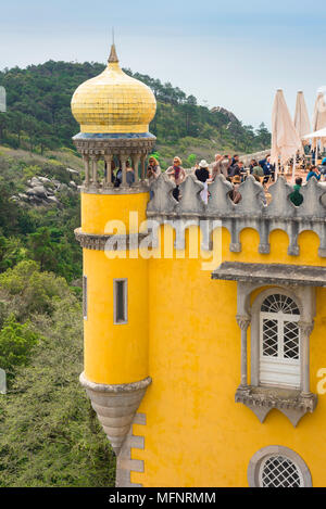 Sintra Portugal, view of an onion-domed turret sited on the roof of the colorful Palacio da Pena in Sintra, Portugal. - Stock Photo