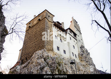 Dracula's Castle  on the top of the rock (Bran Castle), a famous castle of the Count Vlad Tepes, Bran, Romania. Home of the Vampire Dracula, the Bram  - Stock Photo