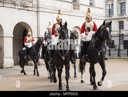 London horseguards, mounted household cavalry also known as lifeguards on black hoses in full dress uniform. - Stock Photo