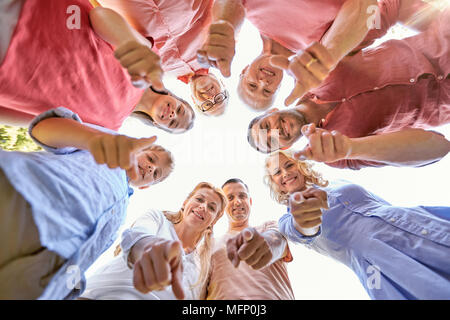 happy family pointing finger at you - Stock Photo