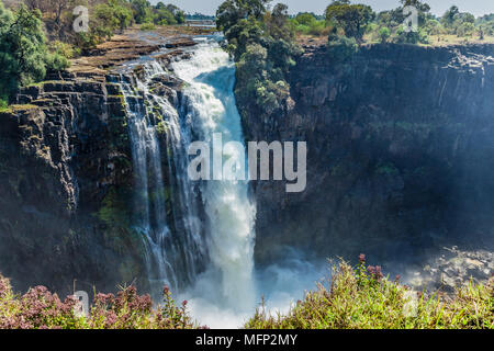 Devil's Cataract is on the Zimbabwe side of Victoria Falls, and is the lowest of the 5 falls with a drop of 60 meters. - Stock Photo