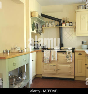 Aga stove in corner of country style kitchen - Stock Photo