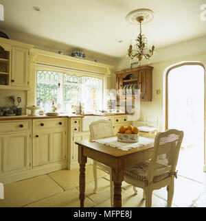 Country Style Kitchen With Pine Dining Table And Chairs Stock Photo