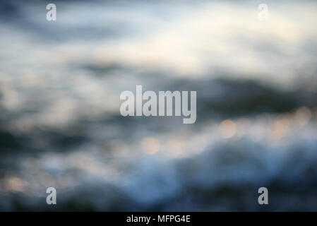 Blurred sea water in the evening light background - Stock Photo
