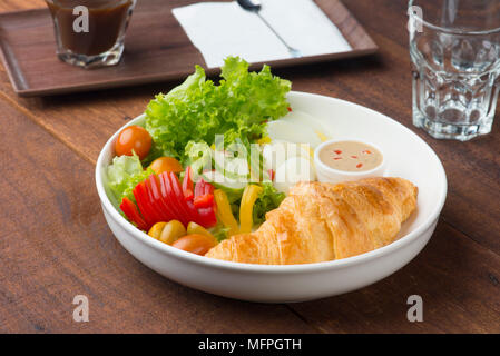 croissand and salad - Stock Photo
