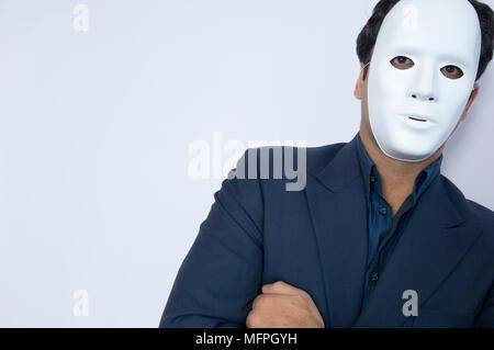 Portrait of a businessman wearing a mask   Ref: CRUSC 10020 039  Compulsory Credit: Staurt Cox / Photoshot - Stock Photo