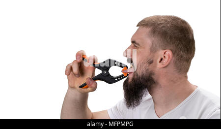 Language barrier, rumors, problems with expressing concept. Man with beard pressed his tongue with a large clothespin. - Stock Photo