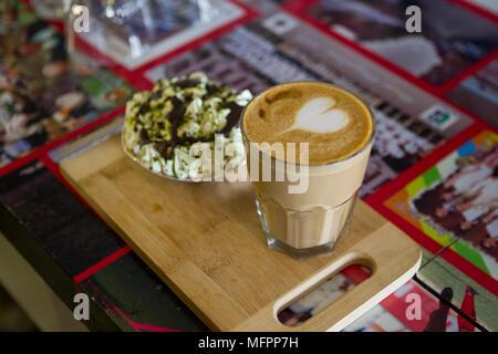 Coffee prepared with latte art heart - Stock Photo