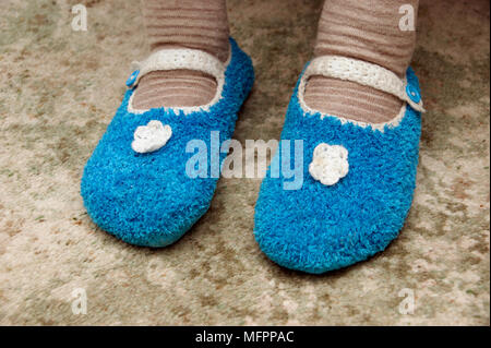 Elderly woman wearing socks & knitted slippers to keep warm and cosy in winter model released - Stock Photo