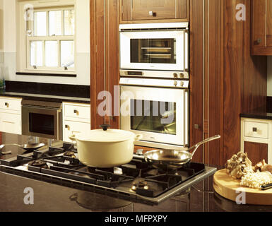 Island Hob Unit In Kitchen With Wooden Ceiling Beams And