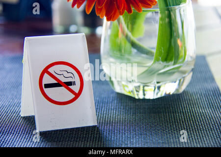 No smoking sign displayed on table - Stock Photo