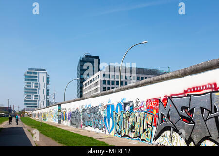 View of original section of Berlin Wall at East Side Gallery in Friedrichshain, Berlin, Germany - Stock Photo