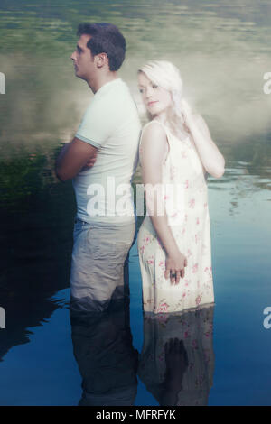 a couple in water, having a conflict - Stock Photo