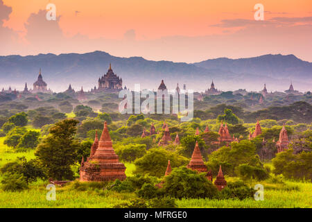 Bagan, Myanmar ancient temple ruins landscape in the archaeological zone at dusk. - Stock Photo