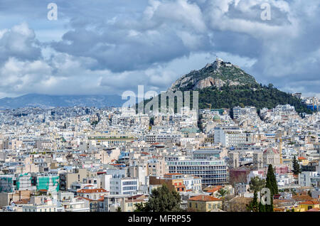 Lycabettus Hill in Athens, Greece. View from Plaka neighborhood beneath Acropolis - Stock Photo