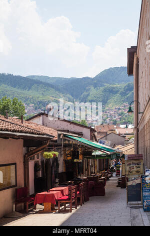 View towards the Dinaric Alps from an alley in the old town of Sarajevo, Bosnia and Herzegovina - Stock Photo