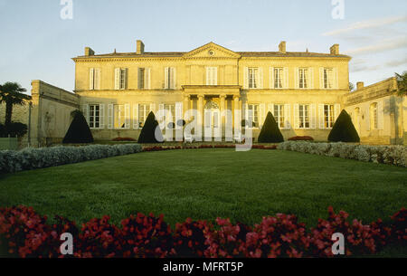 Front view of a French country house with formal garden. - Stock Photo