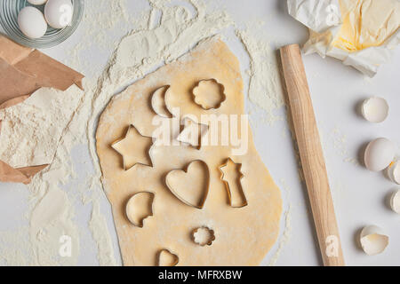 top view of different dough molds on dough - Stock Photo