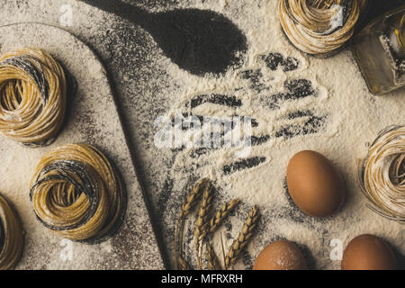 raw pasta and ingredients composition - Stock Photo