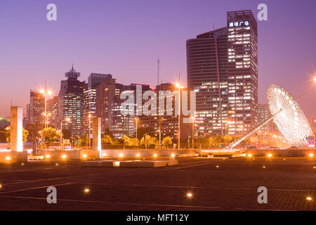 Shanghai, China - Skyline of office buildings from the intersection of Century Avenue and Yanggao Road with sundial sculpture on th - Stock Photo