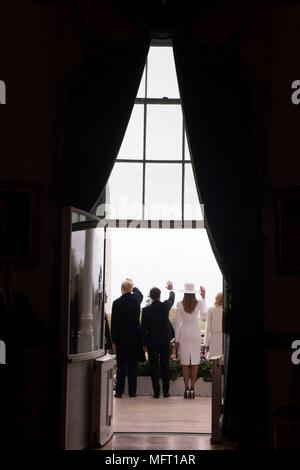 U.S President Donald Trump, left, French President Emmanuel Macron, First Lady Melania Trump and Brigitte Macron, right, wave from the Truman Balcony at the White House during the formal arrival ceremony April 24, 2018 in Washington, DC.  Macron is on a State Visit to Washington, the first since President Trump took office. - Stock Photo