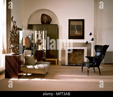 a detail of a modern neutral sitting room with built in cupboards rh alamy com