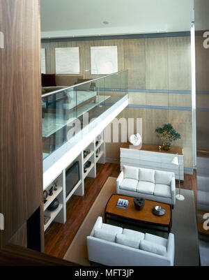 Elevated view of contemporary open plan split level room with sitting area below - Stock Photo