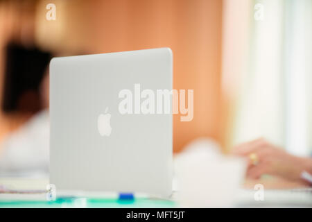 Bangkok, THAILAND - MARCH 17, 2017: Photo of a MacBook Pro. MacBook Pro Retina Display and Apple logo made by Apple Inc. - Stock Photo