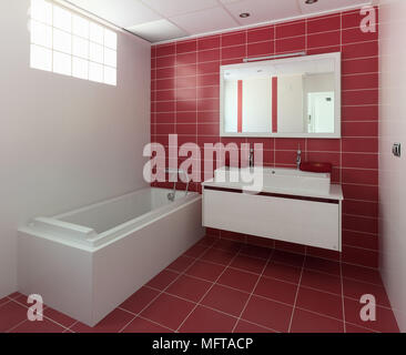 Washbasin on wall mounted unit next to bathtub in modern red bathroom - Stock Photo