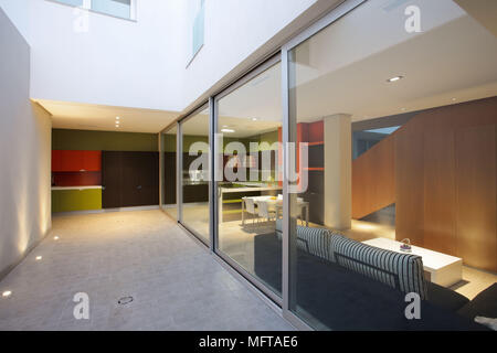 Sliding hallway wall and open plan living room in private residence stock photo 68877399 alamy for Open plan hallway and living room