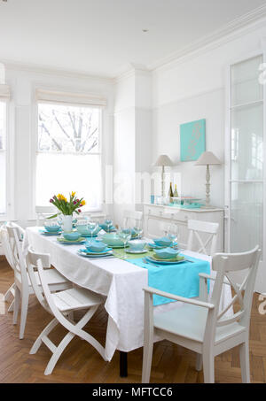 Table laid for dinner in traditional style dining room - Stock Photo