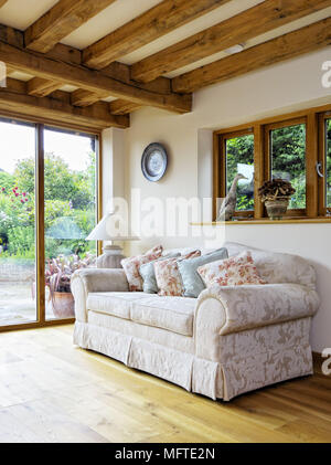 Upholstered sofa in country style sitting room - Stock Photo