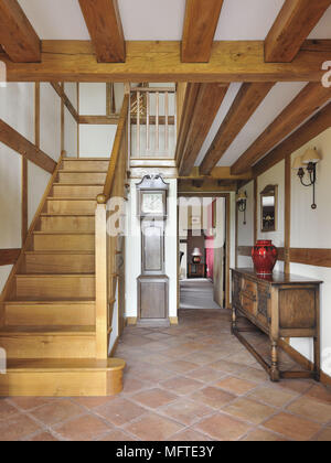 Wooden staircase in modern country style hallway - Stock Photo