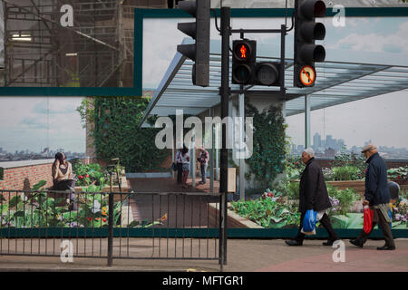 Passers-by and a marketing hoarding for the newest delvelopment at Elephant and Castle called Elephant Park, on 25th April 2018, in London, England. - Stock Photo