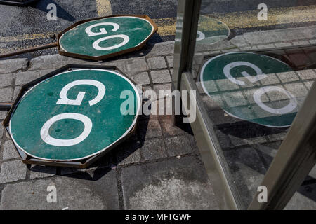 Two GO traffic road signs lie by the road in East Dulwich, on 26th April 2018, in London, England. - Stock Photo