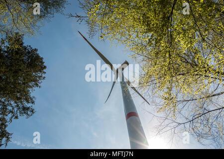 Big windmills for wind power near the village - Stock Photo