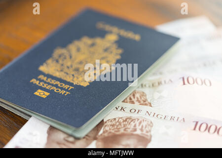 Canadian Passport With Nigerian Naira for business trip or vacation - Stock Photo