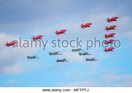 The Red Arrows performing team formation aerobatics at Duxford Battle of Britain 75th anniversary air show on 20 September 2015 in bright sunshine - Stock Photo