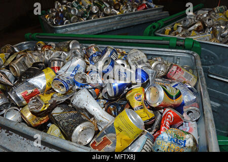 Bins full of wasted discarded aluminium tins cans from the road side - Stock Photo