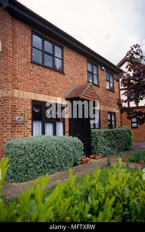 New build red brick housing and front garden - Stock Photo