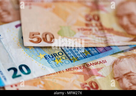 Turkish and European currency - close-up of mixed Lira and Euro banknotes - Stock Photo