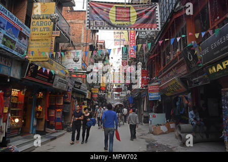 Kathmandu, Nepal - March 24, 2018: Shops and signs at Thamel Marg - Stock Photo