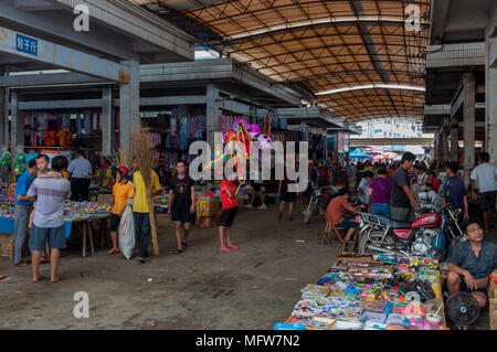 Fuli Village, Yangshuo, Guangxi, China - August 2, 2012: People in a market at the Fuli Village in the countryside of southern China, Asia. - Stock Photo