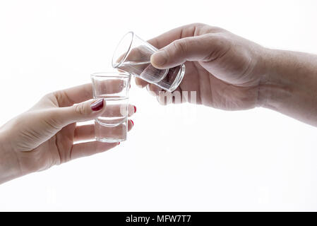 men's and women's hand holding glasses of alcohol