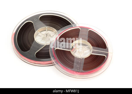 Music and sound - Magnetic tape on a white background. - Stock Photo
