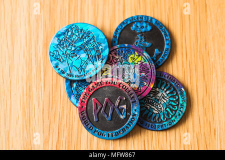 World Pog Federation Slamers. Plastic round Pogs.1990s game for children. Group of pogs on a table. - Stock Photo