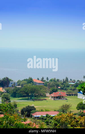 View over the village of Kep in Kampot province, Cambodia from Kep National Park, showing the South China sea and hotel buildings - Stock Photo