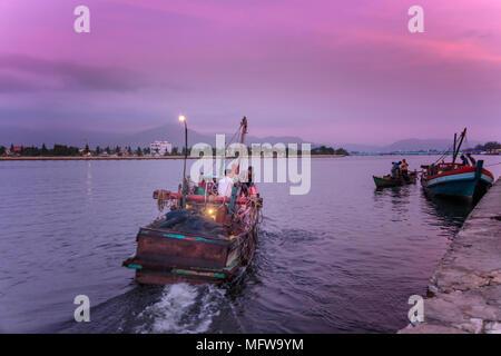 Fishing boats on the Preaek Tuek Chhu river in Kampot town - Stock Photo